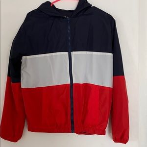Red, white and navy blue windbreaker